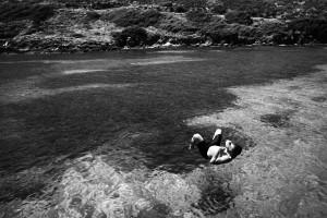 Asinara, Porto Torres, giugno 2010. Un operaio in cassa integrazione della Vinyls fa il bagno in un momento di relax